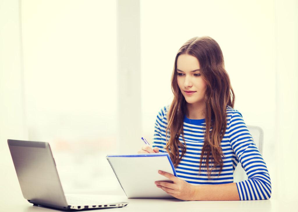 Girl taking notes in online tutoring